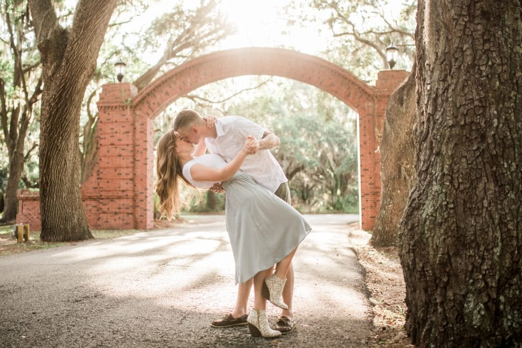 This image contains a lovely couple enjoying an engagement session in Savannah, GA at Bethesda Academy